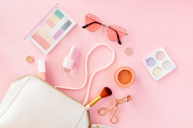 Beauty cosmetics products with bag Free Photo