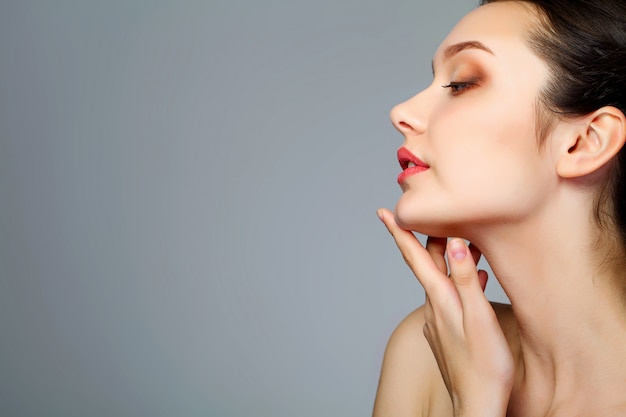 Beauty face of woman with cosmetic cream on face Premium Photo
