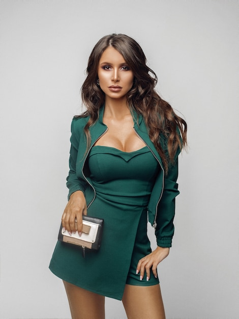 Beauty girl in fashionable green overall and heels. Premium Photo