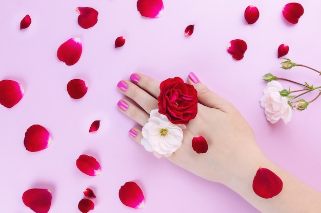 Beauty hands with makeup flowers Premium Photo