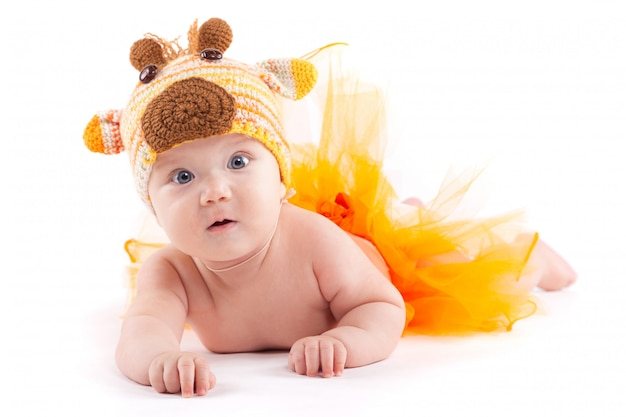 Beauty little boy in orange skirt and deer costume Premium Photo