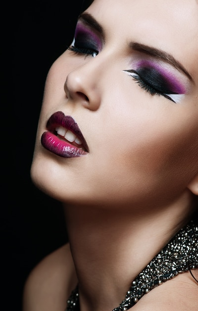 Beauty makeup. purple make-up and colorful bright nails Premium Photo