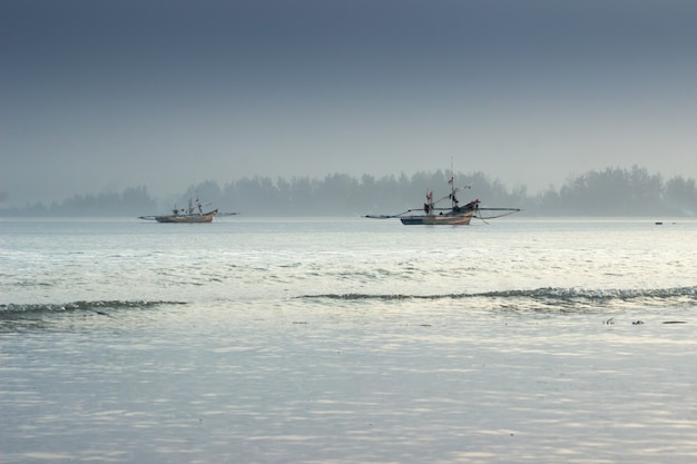 Beauty morning light with shake boat in ocean. bengkulu, indonesia Premium Photo
