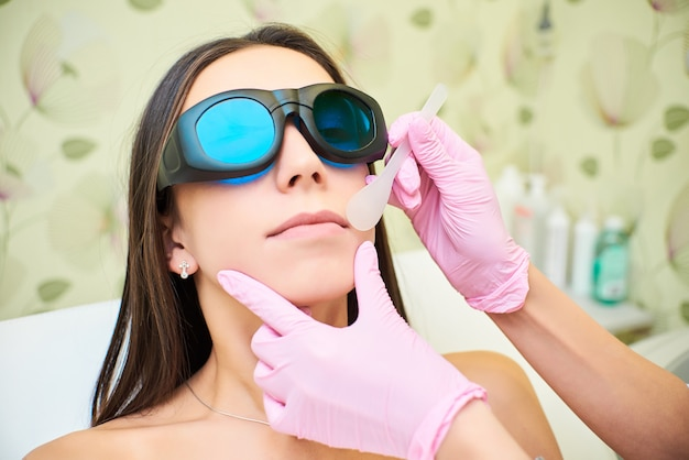 Beauty parlor, laser hair removal, doctor and patient Premium Photo