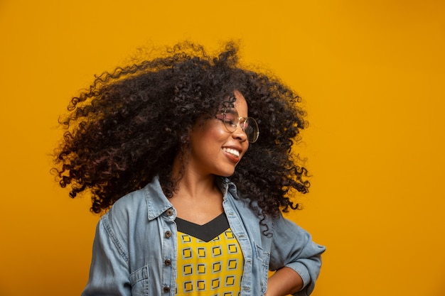 Premium Photo Beauty Portrait Of African American Woman With Afro Hairstyle And Glamour Makeup Brazilian Woman Mixed Race Curly Hair Hair Style Yellow Wall