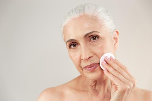 Beauty portrait of a lovely half naked elderly woman Free Photo