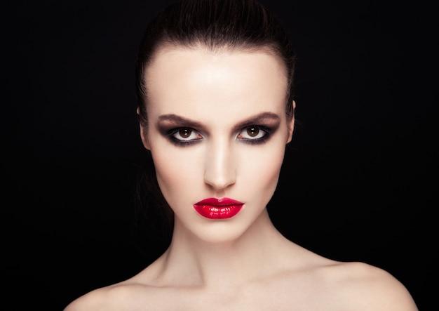 Beauty smokey eyes red lips makeup fashion model on black background Premium Photo