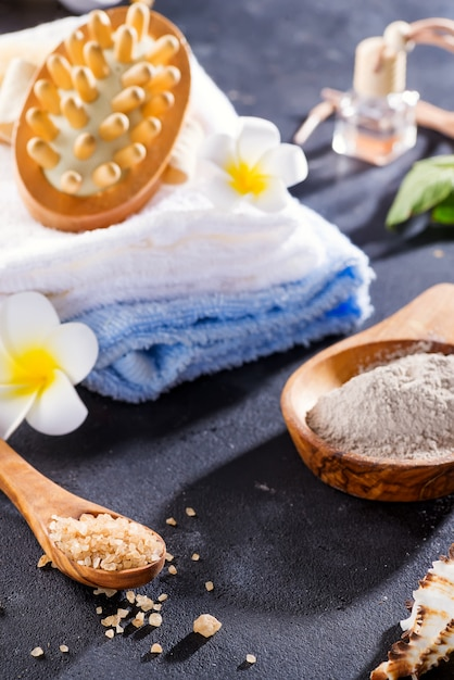 Beauty and spa concept with spa set on dark rustic stone Premium Photo