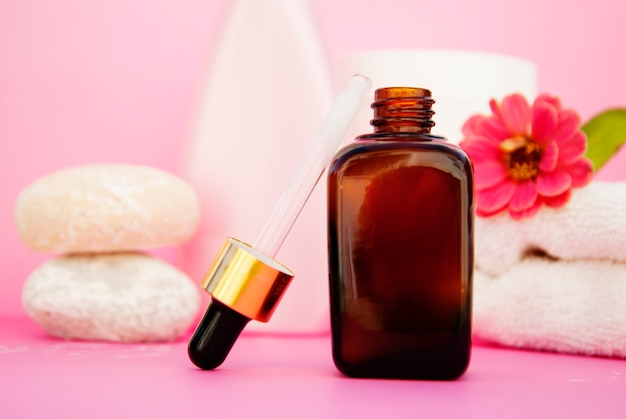 Beauty spa cosmetics, salon therapy . glass bottle on pink . Premium Photo