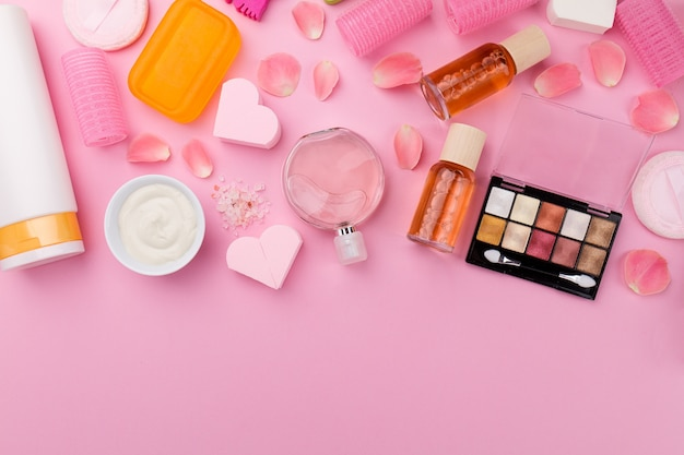 beauty spa feminine concept different make up beauty care essentials cosmetics on flat lay pink
