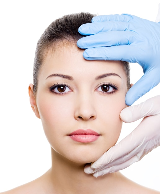 Beauty treatment of the beautiful woman face  on a Free Photo