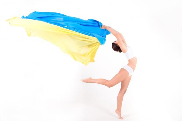 Beauty ukrainian woman with blue and yellow fabric as symbol of ukraine flag Premium Photo