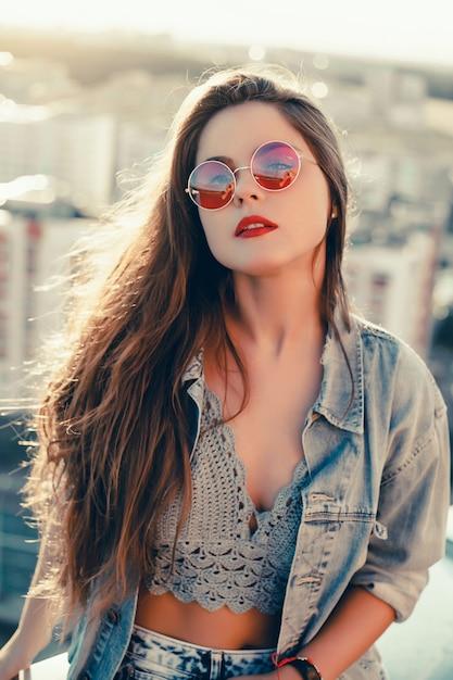 Beauty woman portrait in the street, outdoor portrait, fashion model Free Photo