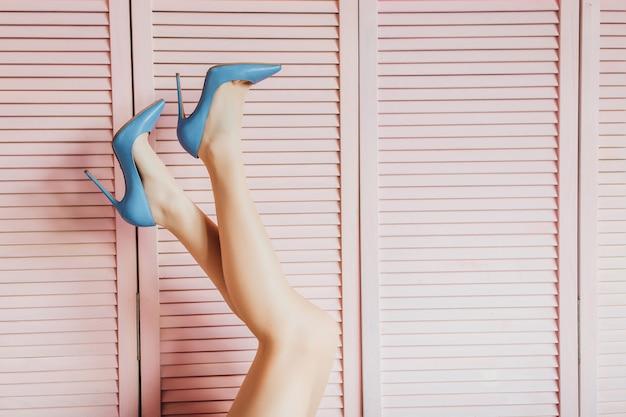 Beauty woman's legs on pink . Premium Photo