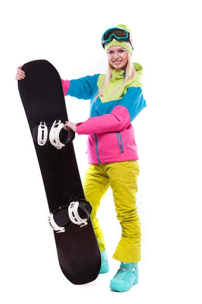 Beauty young woman in ski suit and ski glasses hold snowboard Premium Photo