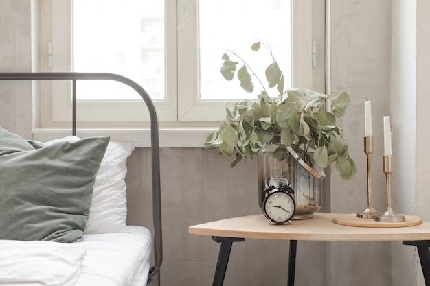 Bedroom interior clock plant pot on wooden table Premium Photo