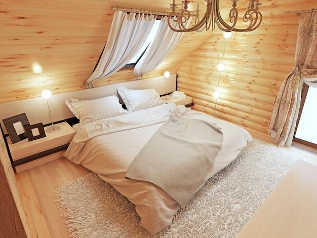 지붕 창문이있는 다락방 바닥에 로그에 침실 인테리어 프리미엄 사진