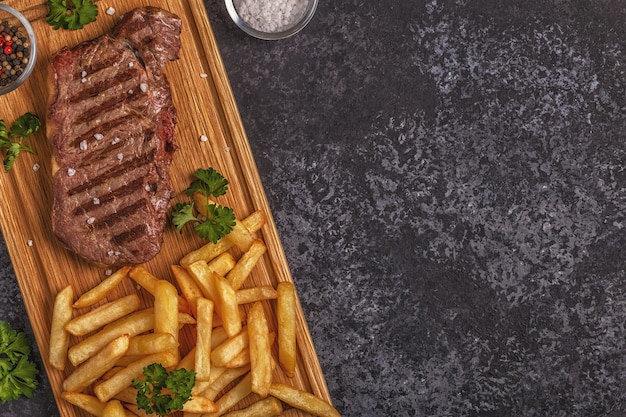 Beef barbecue steak with french fries Premium Photo