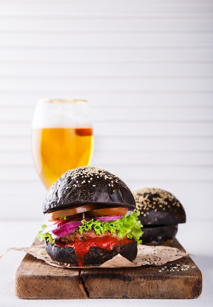 Beef burger with a black bun Premium Photo