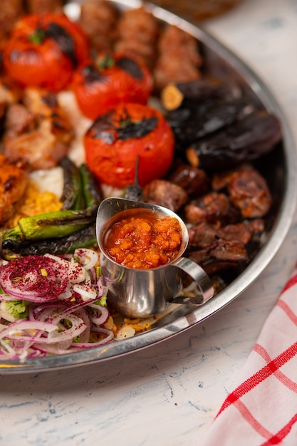 Beef, chicken kebab, bbq with roasted, grilled potatoes, tomatoes and eggplants. Free Photo