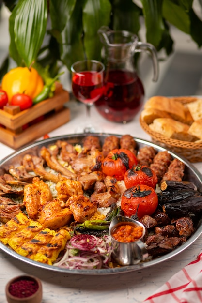 Beef, chicken kebab, bbq with roasted, grilled potatoes, tomatoes and rice. Free Photo