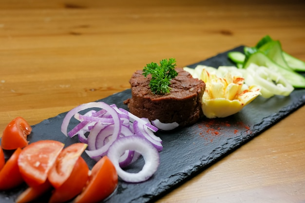 Beef dish in a restaurant Free Photo