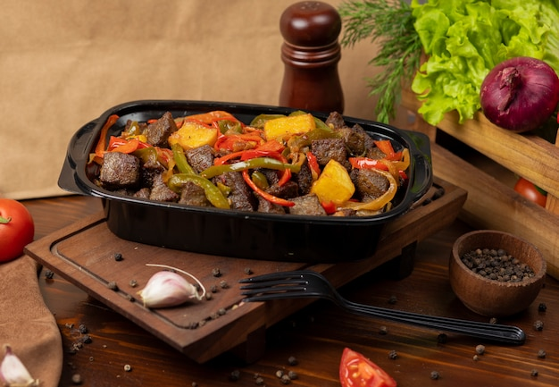 Beef pan baebacue, bbq with grilled potatoes and bell peppers Free Photo