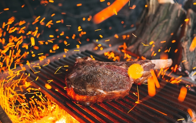 Beef steak is cooked on fire. beef rib bbq . Premium Photo