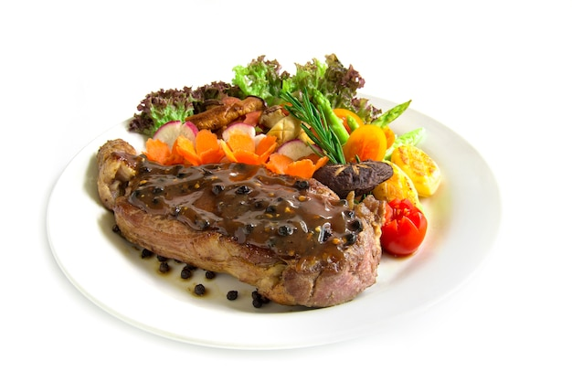 Beef steak with black peppers sauce decorate fresh rosemary, broccoli grilled oyster mushroom Premium Photo