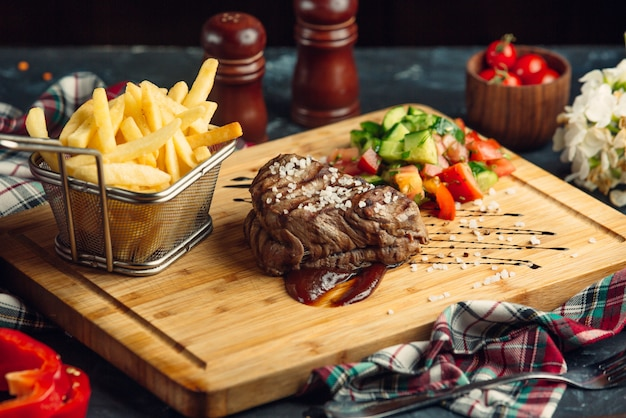 Beef steak with cherry tomato and french fries Free Photo