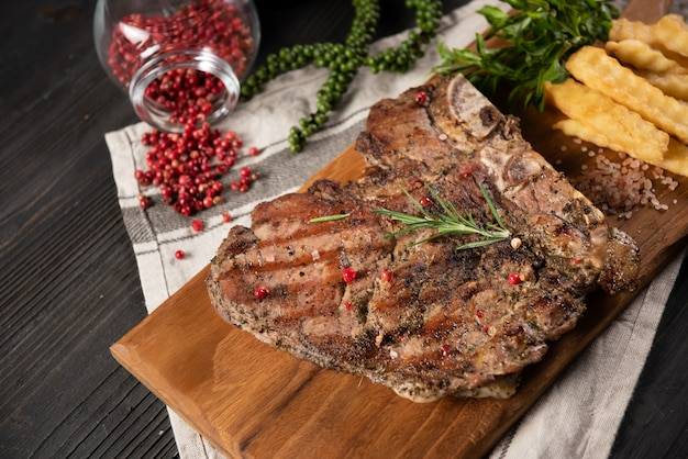 Beef steak with french fries and red pepper Free Photo