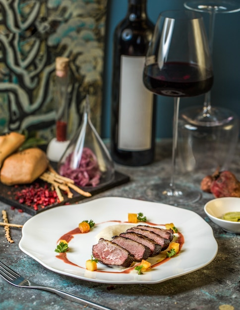 Beef steak with a glass of red wine Free Photo