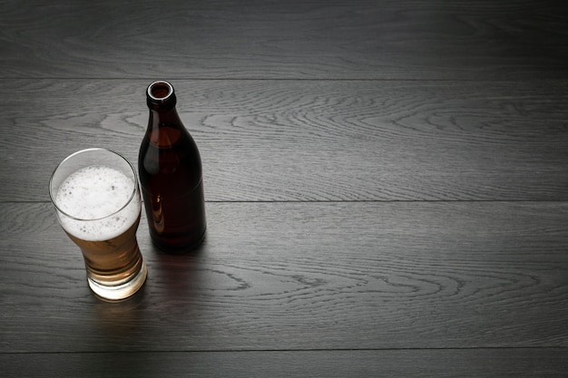Beer bottle and glass with copy space Free Photo