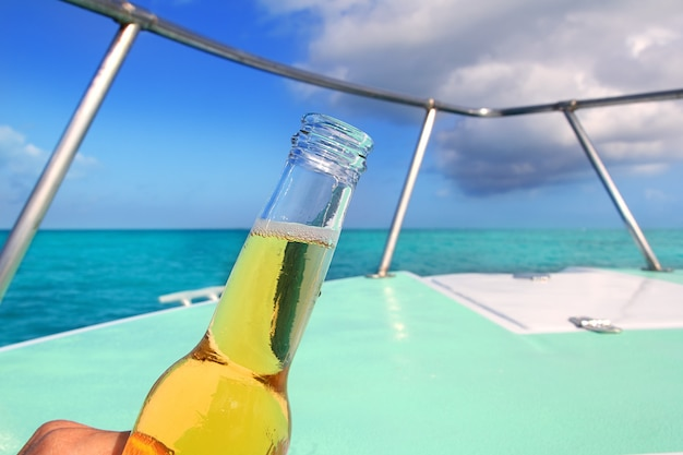 Beer on caribbean boat bow deck turquoise sea Premium Photo