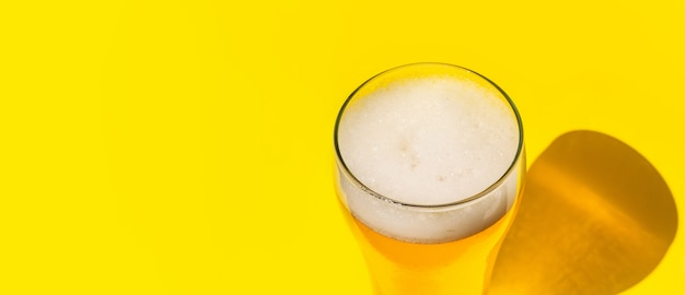 Beer. cold craft light beer in a glass with water drops. pint of beer. oktoberfest concept. Premium Photo