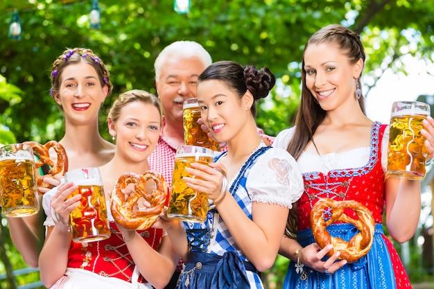 Beer garden - friends drinking in bavaria pub Premium Photo