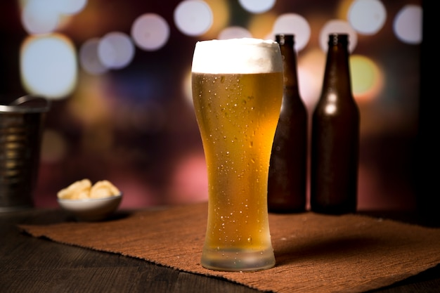 Beer glass in front of blurred background Premium Photo