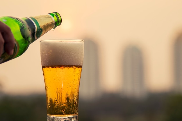 Beer glass and sunset background Premium Photo