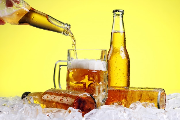 Beer is pouring into glass Free Photo