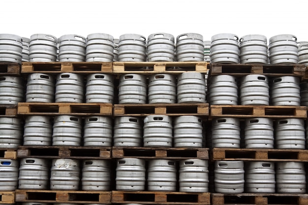 Beer kegs  over white Free Photo