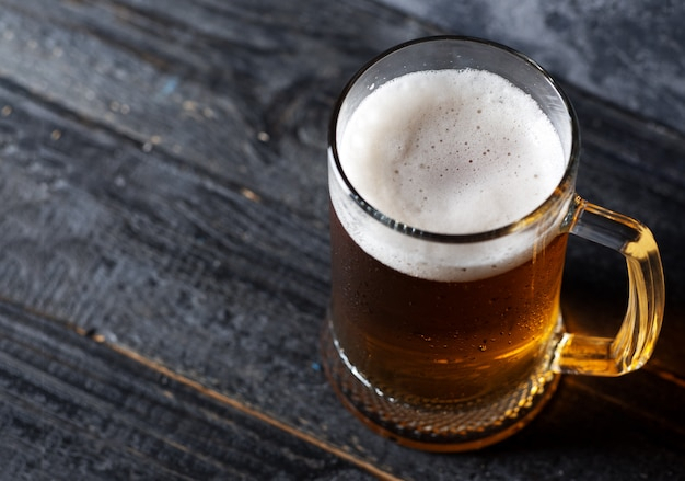 Beer mug with light beer Premium Photo