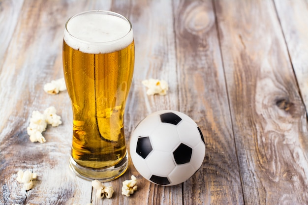 Beer and snacks on wooden table Premium Photo