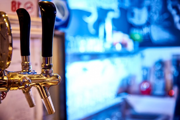 Beer tap on a bright background.copy space. Premium Photo