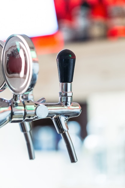 Beer tap in a row Premium Photo