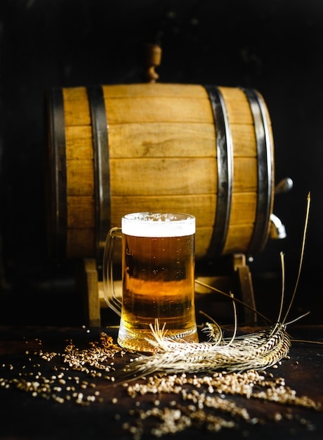 Beer and wheat spice on an old wood table Premium Photo