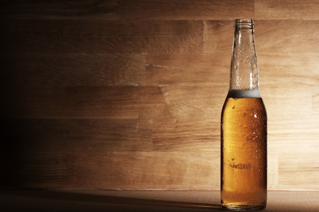 Beer over wooden surface Free Photo