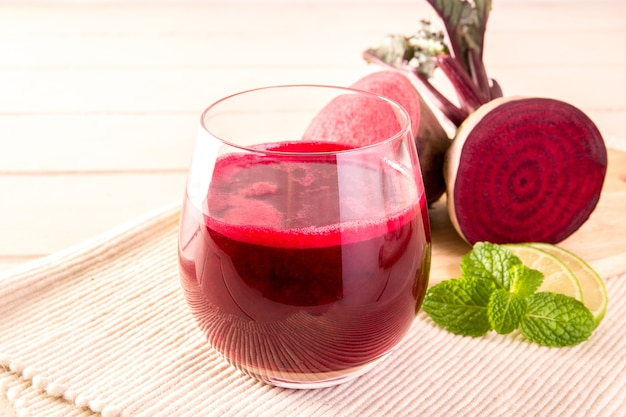 Beetroot cold pressed juice in glass, healthy raw vegetable and fruit drink for detox. Premium Photo