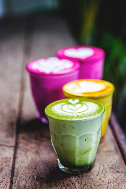 Beetroot, matcha,turmeric lattes are on the marble table. Premium Photo