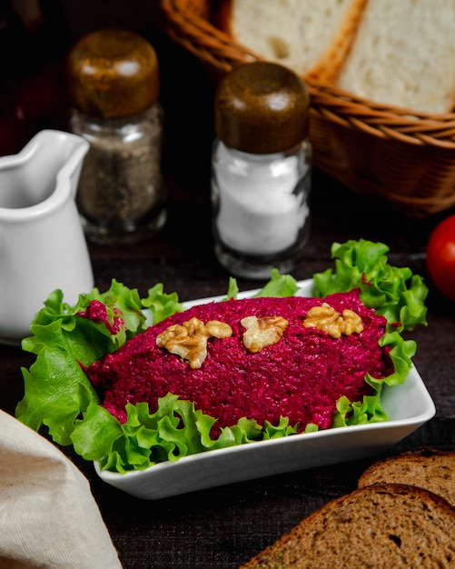 Beetroot salad topped with walnuts Free Photo