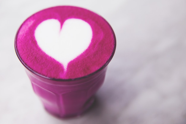 Beetroot super latte on marble background for love Premium Photo
